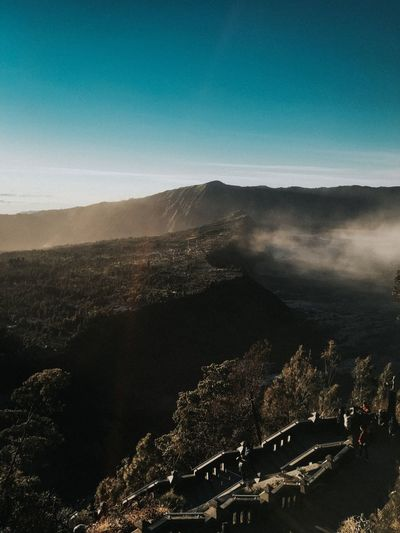 Aerial view of landscape against blue sky in seruni point view bromo mountain