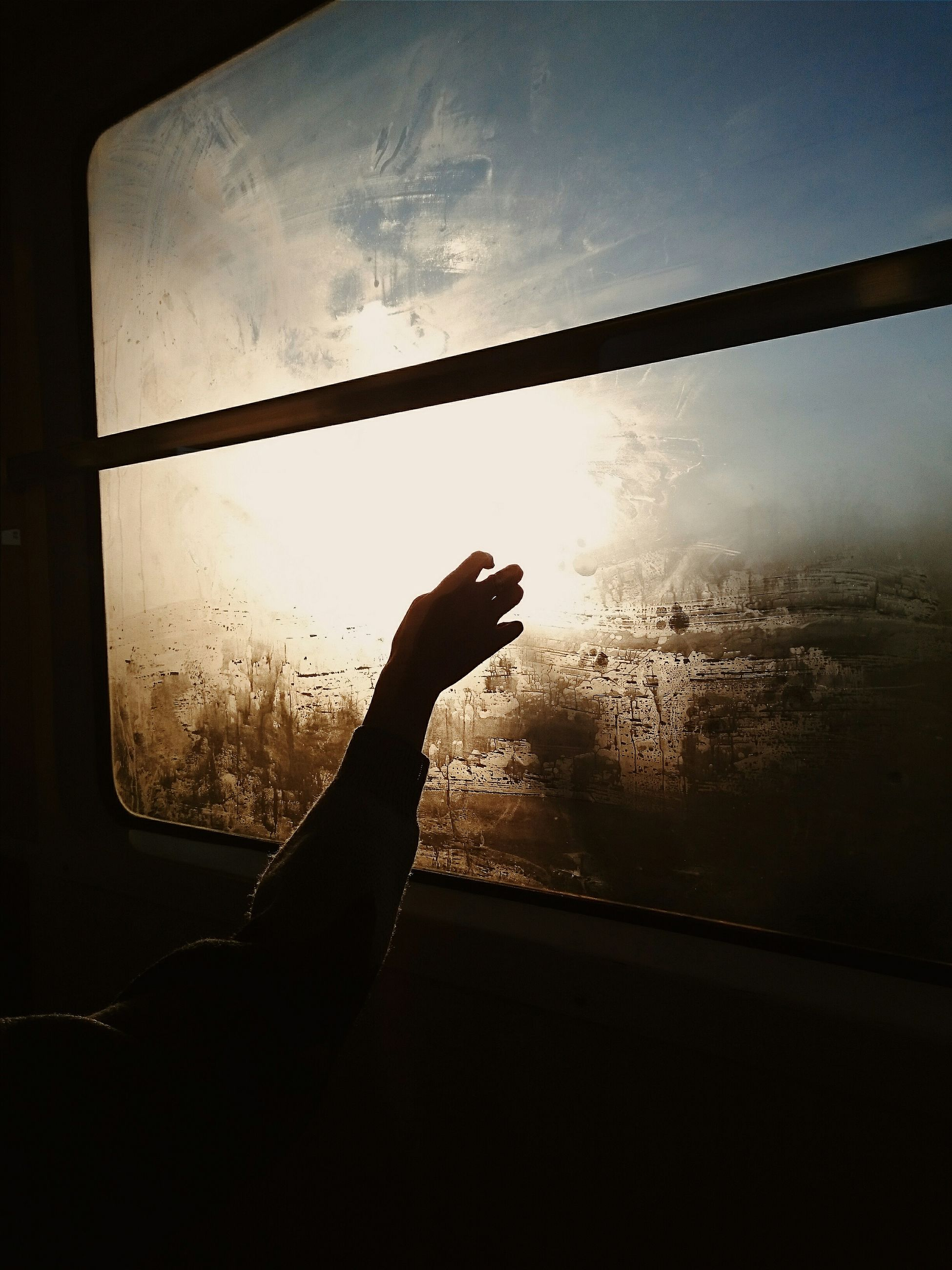 silhouette, window, indoors, person, sky, glass - material, transparent, part of, water, cropped, unrecognizable person, sunset, close-up, reflection, dusk, dark, looking through window
