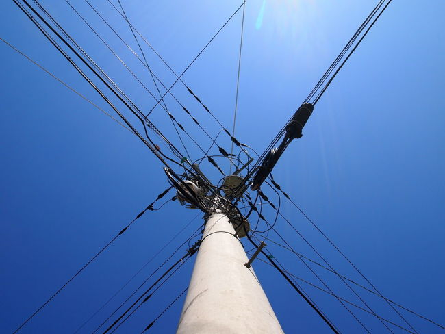 Power Lines Sky Perfect Sky Vertical Electricity  No People Blue Outdoors Day Symmetry Lens Flare Korea Yeonpo Beach Angles Wires Powerlines