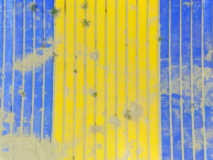 Full frame shot of yellow and blue wooden wall