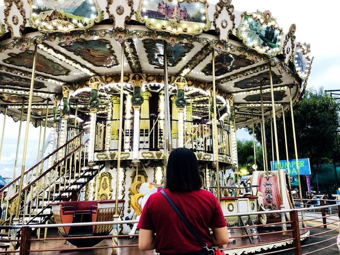 Rear view of woman sitting at amusement park