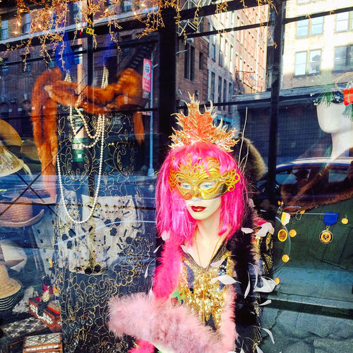 Store window with reflection Casual Clothing City City Life Colorful Costume Cultures Front View Fun Jewelry Lifestyles Mask New York City Reflections Shop Shopping Window
