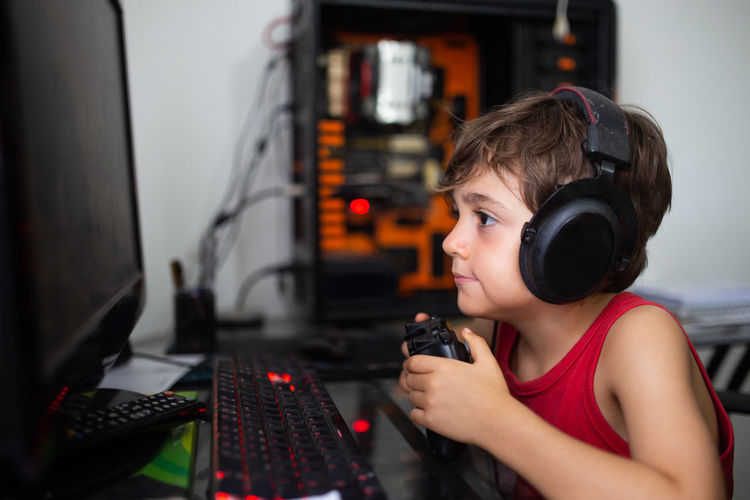 Boy playing with video game