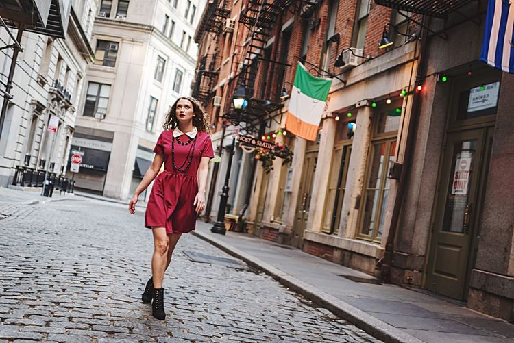 Full length of woman standing on street in city