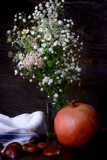 Autumn Fruits, Pomegranate and Chestnuts Chestnuts Apple - Fruit Bouquet Close-up Flower Flower Arrangement Flowering Plant Food Food And Drink Fragility Freshness Fruit Healthy Eating Indoors  Nature No People Plant Pomegranate Still Life Table Vase Vulnerability  Wellbeing Wood - Material