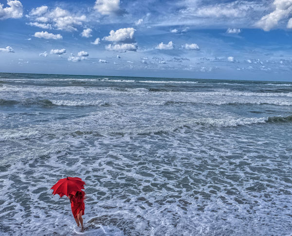 Into the sea Sky Cloud - Sky Sea Outdoors Nature Water Horizon Over Water Lovely Light Tuscany Dream Umbrella Red Umbrella Gildo Masini Sunlight ☀ LollyLove One Person Eyem Vision Colors Fuji X-T1 Adult Beach One Woman Only Italia