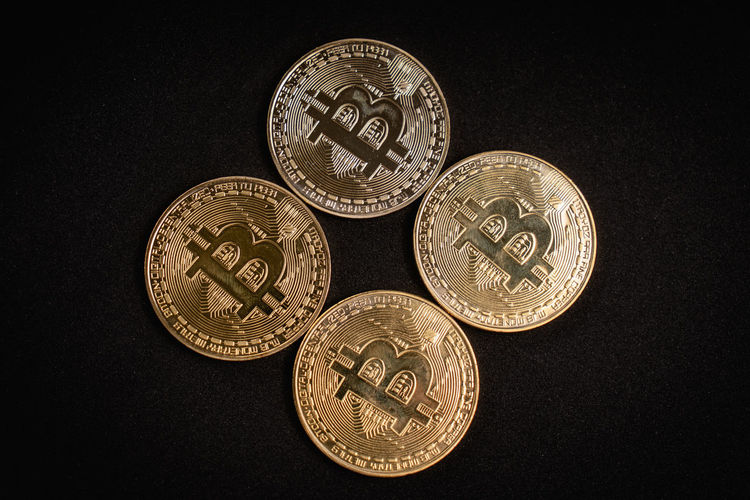 4 bitcoins coins isolated on white background Finance Metal Indoors  Number Text Geometric Shape No People Studio Shot Close-up Gold Colored Circle High Angle View Black Background Still Life Silver Colored Shape Communication Coin Currency Wealth Business Economy Four Bitcoin Cripto Currency Criptocurrency Beauty In Nature Blackandwhite Isolated