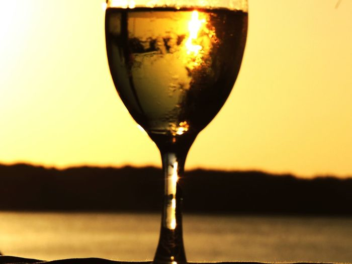 Focus On Foreground Drink Sunset Food And Drink Alcohol No People Wine Wineglass Refreshment Close-up Freshness Outdoors Water Drinking Glass Watamu Beach Kenya Refelections Sky And Sea After A Hard Work Day... Evening Light Friday Night Mangroove Forest Relaxing Moments Happy Hour