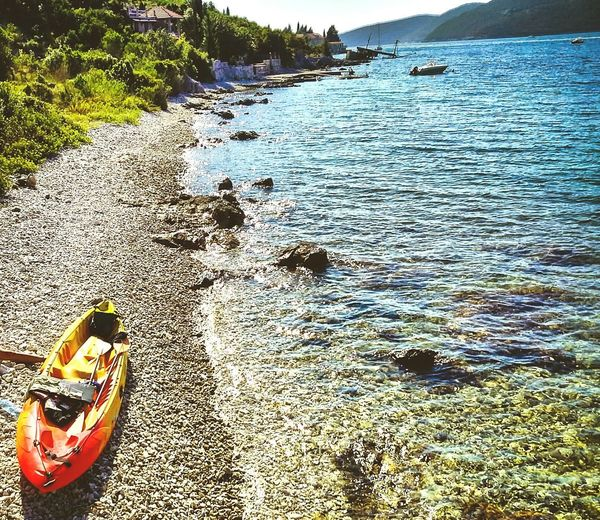 Adventure mode Kayaking Visual Creativity Travel Going Remote Summer Road Tripping Water Beach Sea Sand Rippled Sunlight Close-up Tranquil Scene Shore Horizon Over Water Boat Water Vehicle Nautical Vessel Sandy Beach
