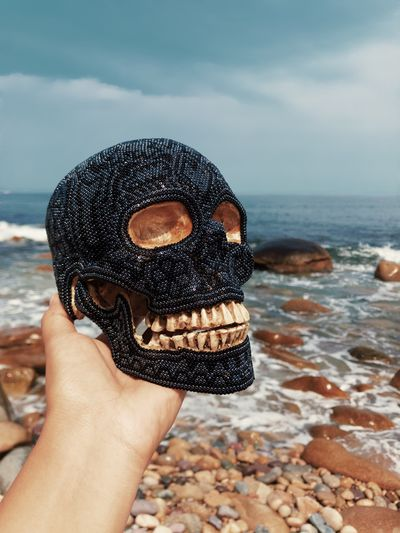 Craft Skull Huichol Huicholart One Person Real People Beach Close-up Sky Outdoors Horizon Over Water