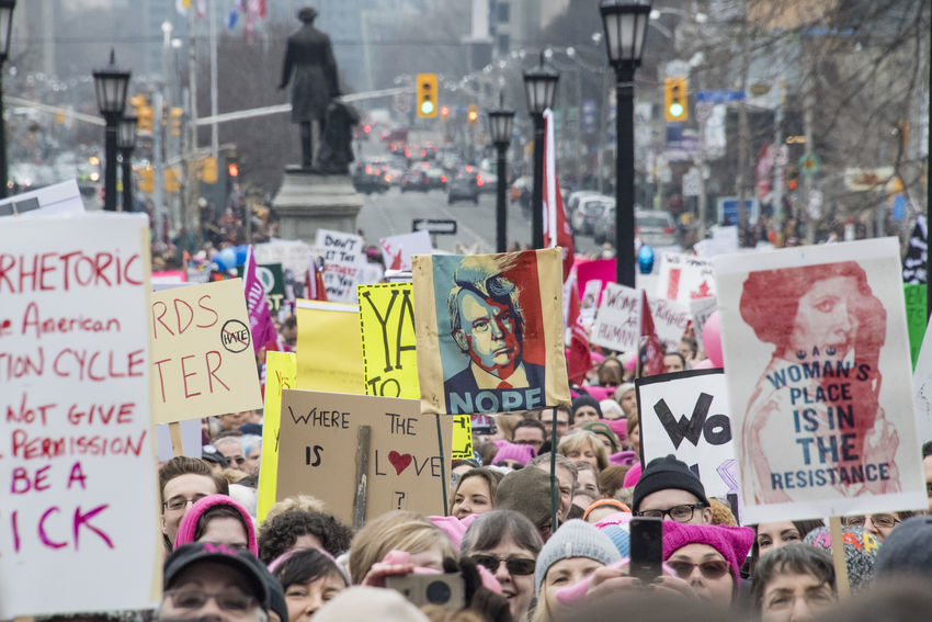 Many signs and crowd in Queen's Park. Women's Solidarity March in Toronto, Canada. January 21, 2017 marked the history of the capital city of Ontario with one of the largest protest march gathering more than 60,000 people. Women were claiming more social justice and protesting many of Donald Trump stances. Anti-trump Canada Canadian Demanding  Democracy Freedom Girls Leftist March Movement Ontario People Power Revolution Signs Social Justice Symbols Toronto Toronto Canada Women's March Women's Solidarity March