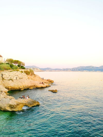 Marseille, France France🇫🇷 Sea Beach Water Scenics Outdoors Nature Tranquil Scene Beauty In Nature Sunset Tranquility Vacations Travel Destinations Horizon Over Water Summer Sky Landscape Pastel Colored People Togetherness Rocks Rocks And Water Beauty