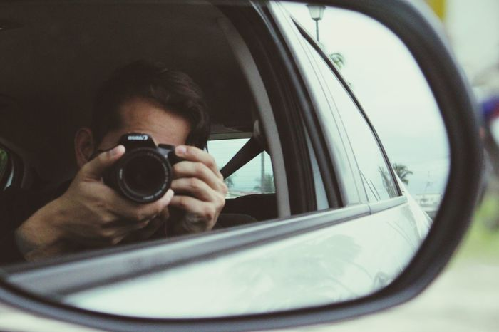 EyeEm Selects Photography Themes Mirror Photographing Camera - Photographic Equipment Car Technology Adult One Person Digital Camera One Man Only Photographer Headshot People Day Transportation Adults Only Only Men Men Indoors  SLR Camera
