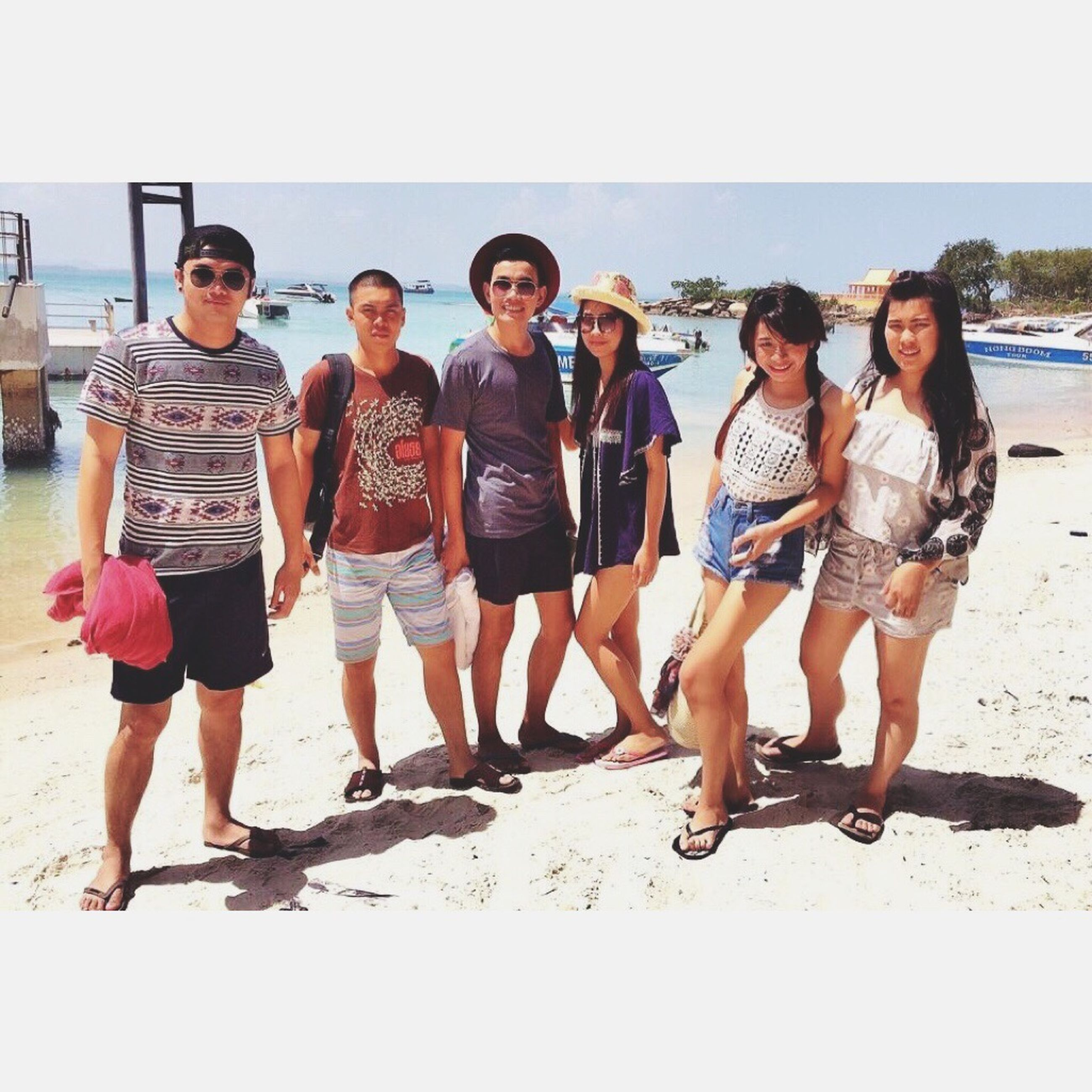 togetherness, bonding, lifestyles, leisure activity, love, beach, friendship, person, young men, young adult, casual clothing, happiness, smiling, vacations, full length, family, sea, looking at camera
