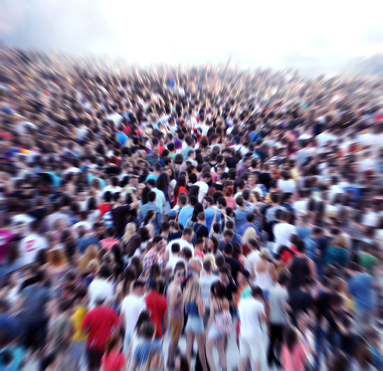 High angle view of people on street against sky
