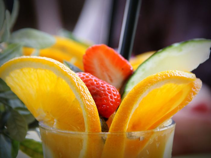 Close-up of fruit slices in drinking glass