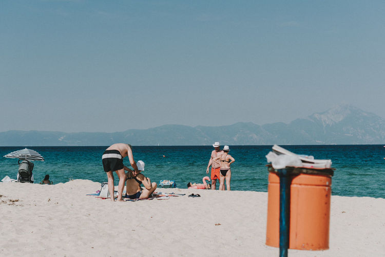 Travel Beach Beauty In Nature Clear Sky Copy Space Day Greece Group Of People Holiday Land Leisure Activity Lifestyles Mountain Nature Outdoors People Real People Scenics - Nature Sea Sky Summer Water Women