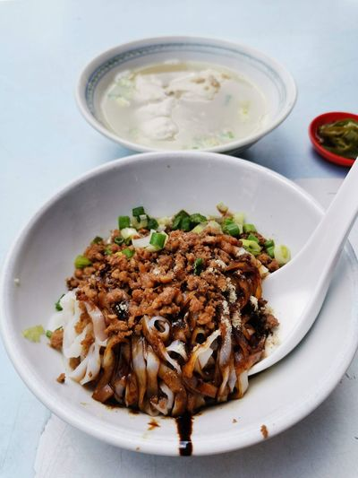 High angle view of asian noodle or kuey teow meal served on table.