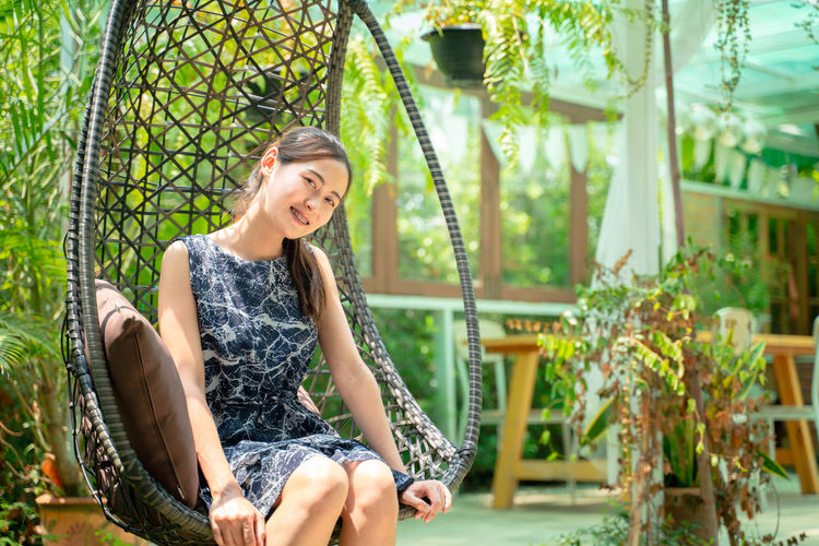 Smiling One Person Young Adult Sitting Happiness Plant Young Women Casual Clothing Real People Nature Teeth Leisure Activity Adult Toothy Smile Three Quarter Length Day Emotion Hair Lifestyles Beautiful Woman Hairstyle Outdoors