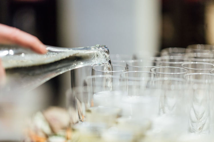 Human Hand Hand Human Body Part One Person Indoors  Water Real People Holding Unrecognizable Person Motion Close-up Selective Focus Pouring Focus On Foreground Body Part Preparation  Nature Drink Glass Finger Celebration Champagne