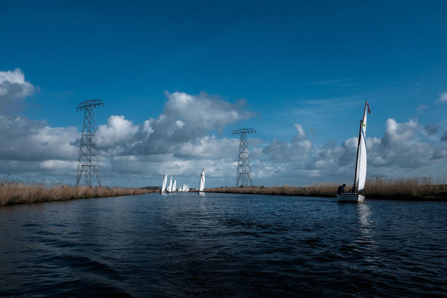 Boat Clouds Day Dutch Dutch Landscape Electricity Pylon Friesland Harbor Holland Nature No People Old Master Outdoors Sailing Sailing Ship Sea Sky Water White Sail