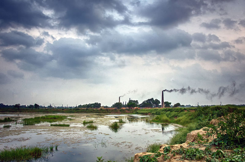 Air pollution Earth Air Pollution Airpollution Architecture Building Exterior Built Structure Cloud - Sky Day Environment Environmental Issues Factory Industry Nature No People Outdoors Overcast Plant Pollution Sky Smoke Stack Tree Water Waterpollution