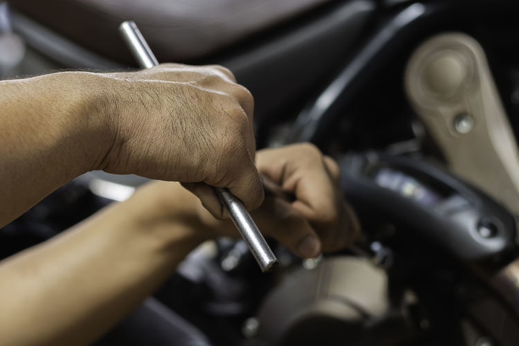 Close-up of man working on car