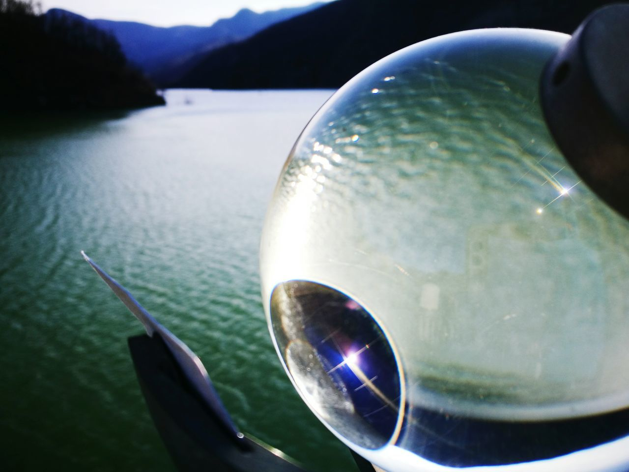 water, no people, close-up, reflection, crystal ball, outdoors, nature, day, beauty in nature, sky