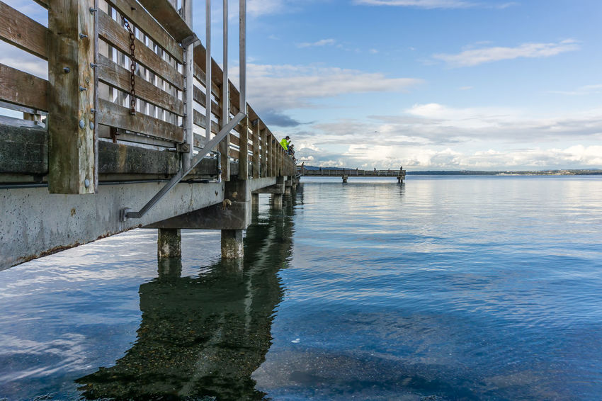 Fishing pier in Dash Point, Washington. Pier Architecture Bridge Building Building Exterior Built Structure Cloud - Sky Connection Dash Point Day Landscape Nature No People Ocean Outdoors Reflection River Sky Tranquility Transportation Water Waterfront Wood - Material