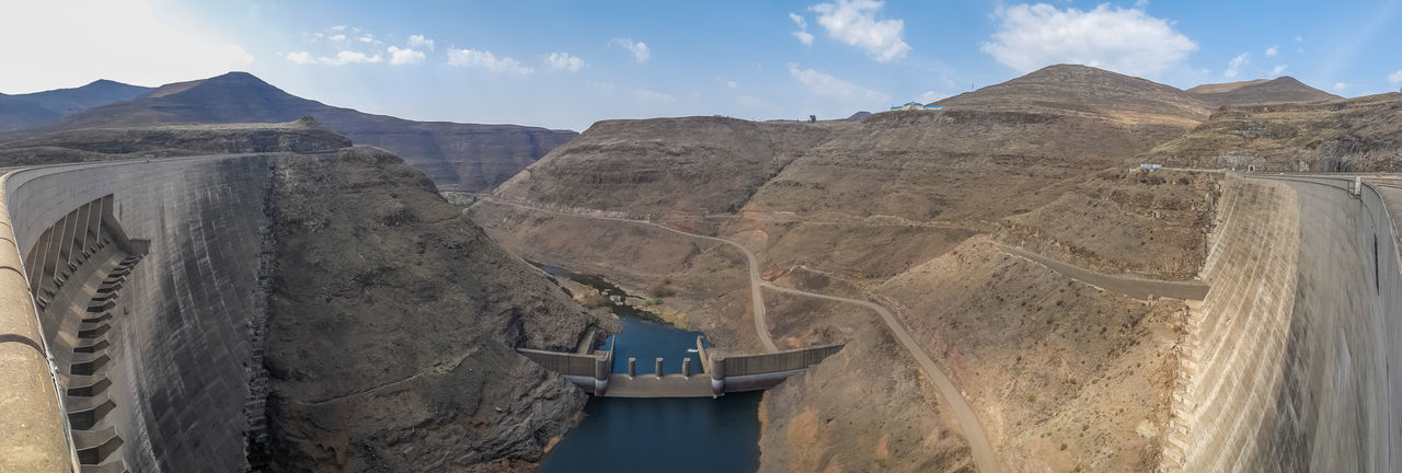Panorama of hydroelectric Katse Dam power plant in Lesotho, Africa with view downriver. Lesotho Panorama Panoramic Perspective Africa Architecture Beauty In Nature Built Structure Dam Day Fuel And Power Generation Hydro Power Hydroelectric Power Mountain Mountain Range Nature No People Outdoors Panoramic Photography Reservoir River Scenics Sky Transportation Water