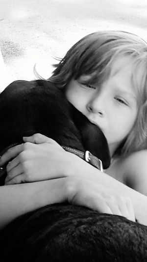 My son finding comfort in his faithful friend. Brody A Boy AutismSpeaks Withoutwords Animal Speak Blackandwhite Canine Companion SirJake