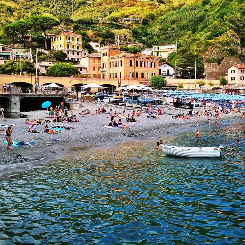 #cinqueterre #italy #mediterraneanfish #monterosso Building Exterior Crowd Day Large Group Of People Leisure Activity Lifestyles Men Mixed Age Range Outdoors People Real People Tree Water Women