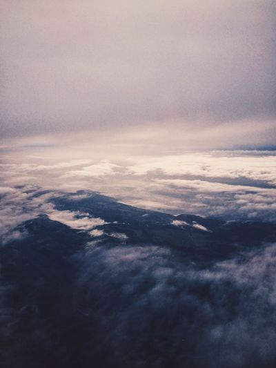 Aerial view of clouds over mountain