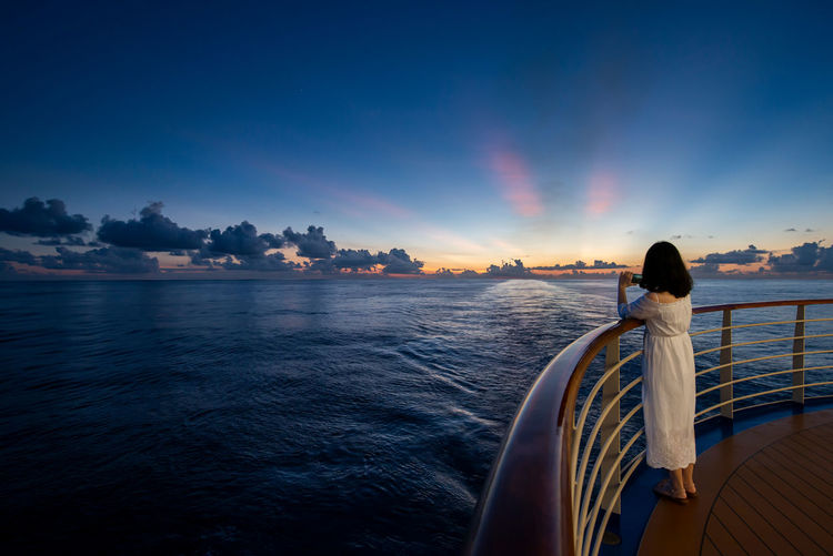Shooting the sunset Water Sky One Person Sea Beauty In Nature Sunset Rear View Nature Leisure Activity Standing Women Dusk Shooting Blue Glowing Deck Majestic Princess