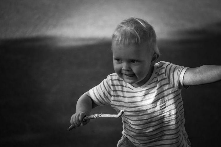 Playful boy holding stick