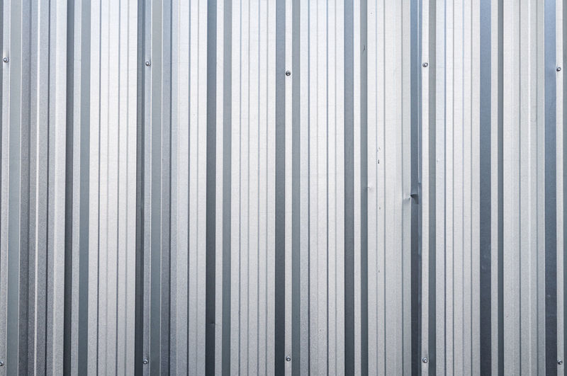 Vertical zinc aluminium closeup background metal square ,abstract background Abstract Aluminium Architecture Backgrounds Built Structure Business Close-up Corrugated Corrugated Iron Full Frame Industry Iron Metal No People Pattern Repetition Security Silver Colored Striped Textured  Vertical Wall - Building Feature Zinc Zinc Roof Zinc Wall