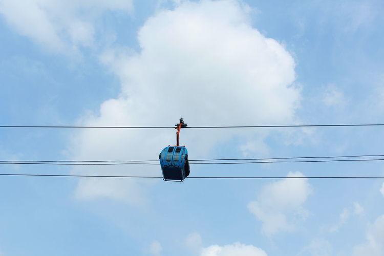 Low angle view of cable car against blue sky