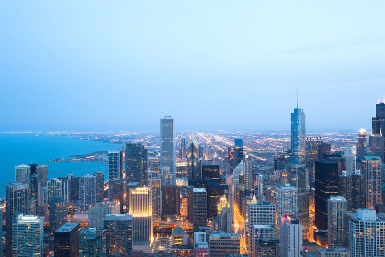 Aerial view of the skyline of downtown Chicago at night, Illinois, USA Chicago Illinois Magnificent Mile Aerial Architecture Building Exterior City City Life Cityscape Crowded High Angle View Illuminated Modern Night Skyscraper Travel Destinations Urban Skyline