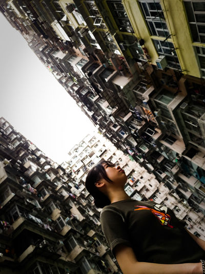 We all trapped by the city. City Sky Building Buildings Architecture Girl Littlegirl HongKong Neighborhood Map The Street Photographer - 2017 EyeEm Awards