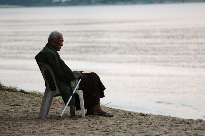 Lonely Loneliness Isolation Isolated Old Age Full Length Sitting Gray Hair Senior Adult Men Differing Abilities Retirement Senior Men Rural Scene