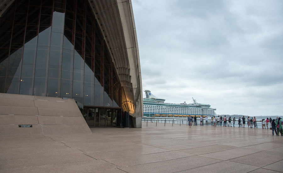 Sydney,NSW,Australia-November 19,2016: Tourists at the Sydney Opera House with cruise ship in Sydney, Australia. 20th Century Architecture Australia Cloud Cruise Ship Exploring Façade Opera House By Night Performing Arts Venue Sydney Opera House Tourists Travel Venue Building Exterior Concrete Expressionist Famous Place Glass Landmark Opera House Real People Sydney Tourism Tranportation Window