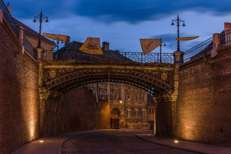 Nightlight of old town Sibiu Sibiu, Romania Bridge Night Lights Nightphotography Night Architecture Built Structure Building Exterior Sky Cloud - Sky No People Illuminated The Way Forward Arch Direction Building Lighting Equipment Outdoors Street Transportation History Street Light City
