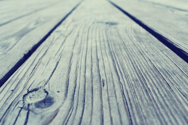 Close-up of wooden plank on table