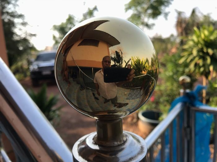 Close-up of crystal ball on metal railing