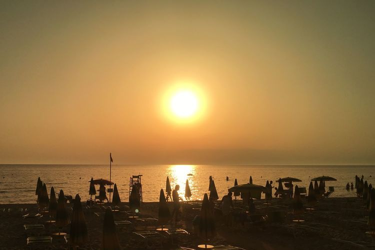 GOLDEN SUN Water Sea Sky Sunset Sun Scenics - Nature Summer Road Tripping Beauty In Nature Horizon Over Water Beach Nature Sunlight Land Tranquility Tranquil Scene Silhouette Orange Color Reflection Idyllic Outdoors Horizon