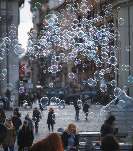 Piazza del Popolo Bubble Real People Soap Sud Bubble Wand Vulnerability  Women Fragility Men Adult Leisure Activity Lifestyles Mid-air Group Of People Motion Architecture Transparent People Built Structure Day Outdoors Lightweight