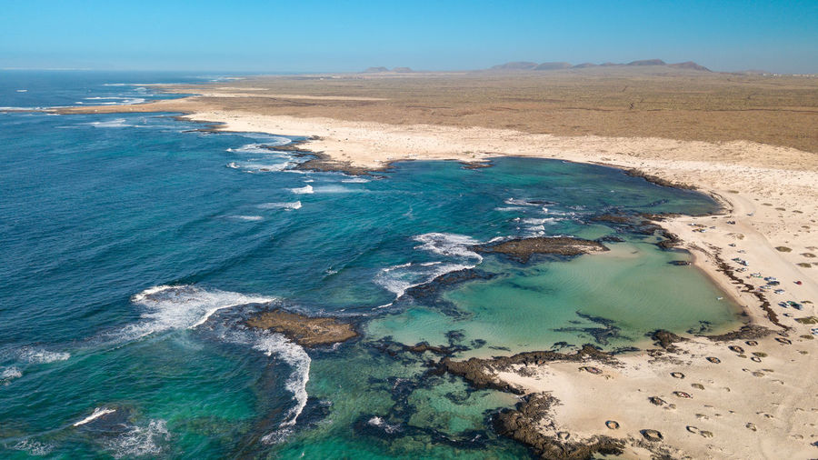 aerial view north coast of fuerteventura Water Sea Beauty In Nature Scenics - Nature Land Tranquil Scene Tranquility Day Nature No People Beach Sky Aerial View Idyllic Blue High Angle View Non-urban Scene Outdoors Turquoise Colored
