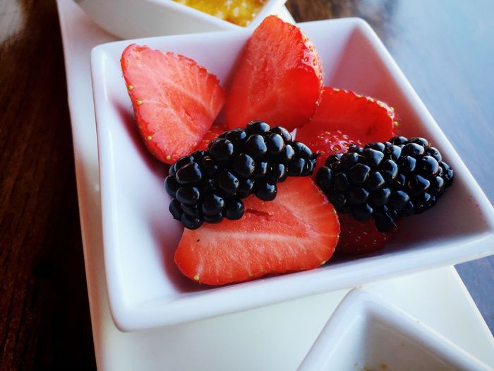 Close-up of fresh strawberry and blackberries in bowl