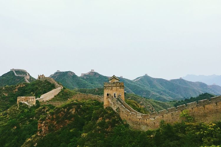 Great Wall Of China On Green Mountains Against Clear Sky