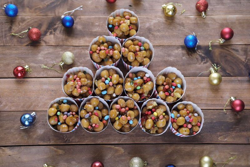 Neapolitan traditional Christmas cake called Struffoli presented in a Christmas tree shape with Christmas decoration Christmas Feast Shape Struffoli X-Mas Tree X-mas X-mas Time X-mas Decoration Cake Christmas Tree Food Neapolitan Ready-to-eat Struffolinatalizi Sweet Traditional Food Stories